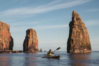 Kayaker among sea stacks, Braewick