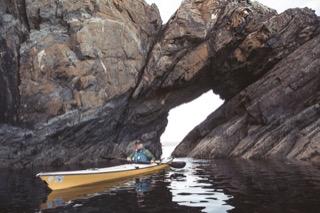 Kayaker and natural arch, Gletness