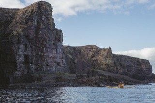 Kayaker below Brindister cliffs