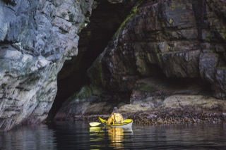 Kayaker in cave, Brindister cliffs