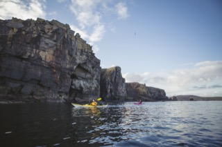 Kayakers below Brindister cliffs