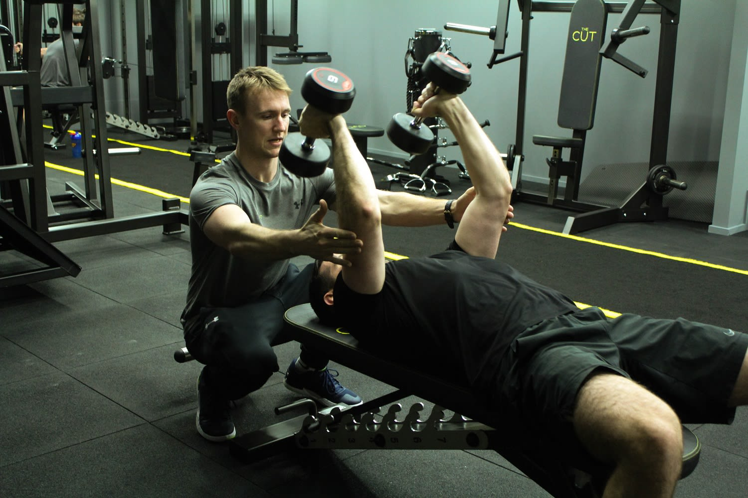 Steve Training Skull Crushers With Client in the Studio