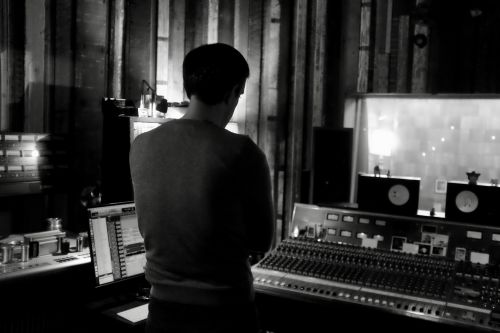 Image of Beau (the engineer) intensely listening to mixes