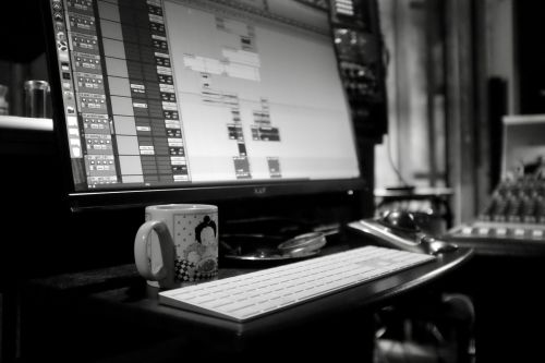 Image of the Pro Tools session and a coffee mug