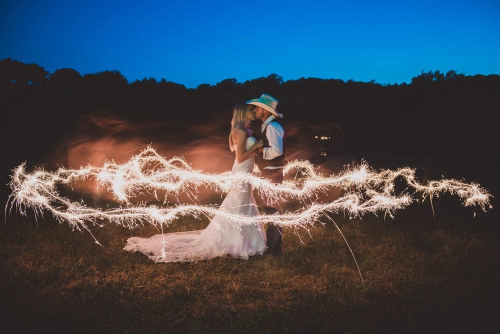 late night sparkler couple portrait