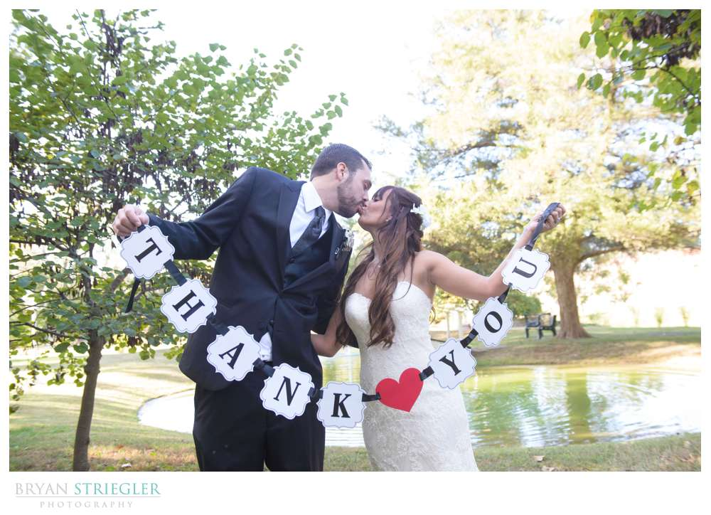 wedding couple with thank you sign