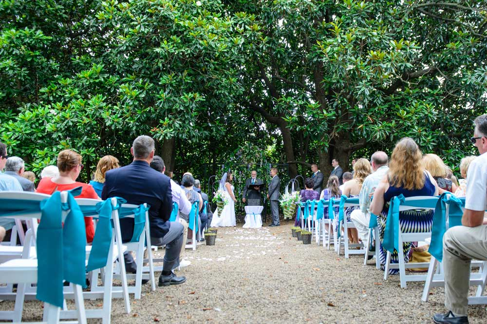 outdoor wedding in front of large magnolia tree