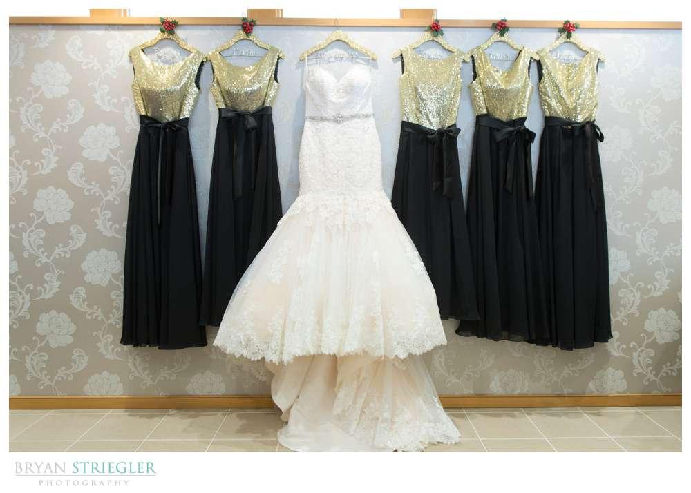 wedding dress and bridesmaids dresses hanging