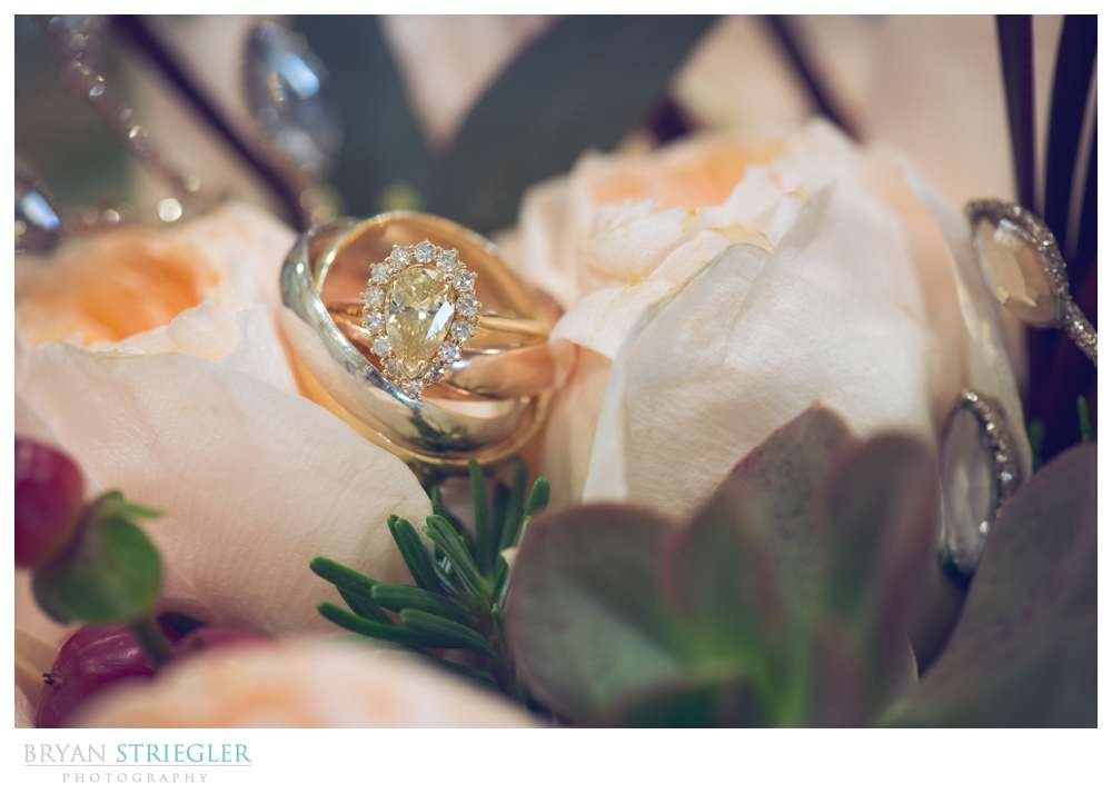 wedding and engagement ring in flowers