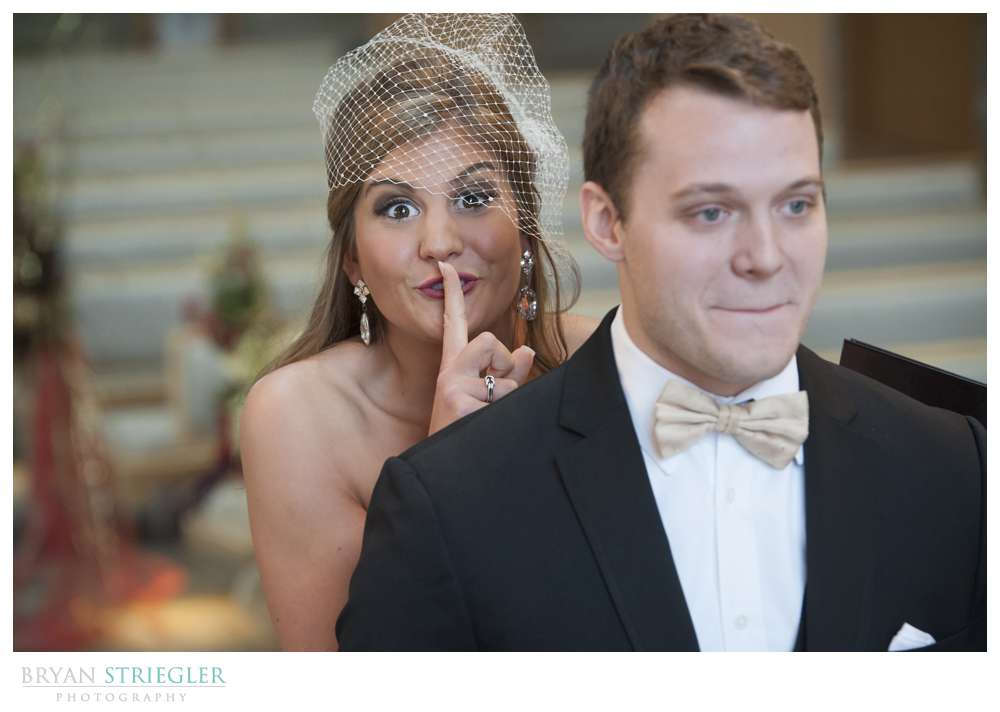 bride sneaking up on groom for first look
