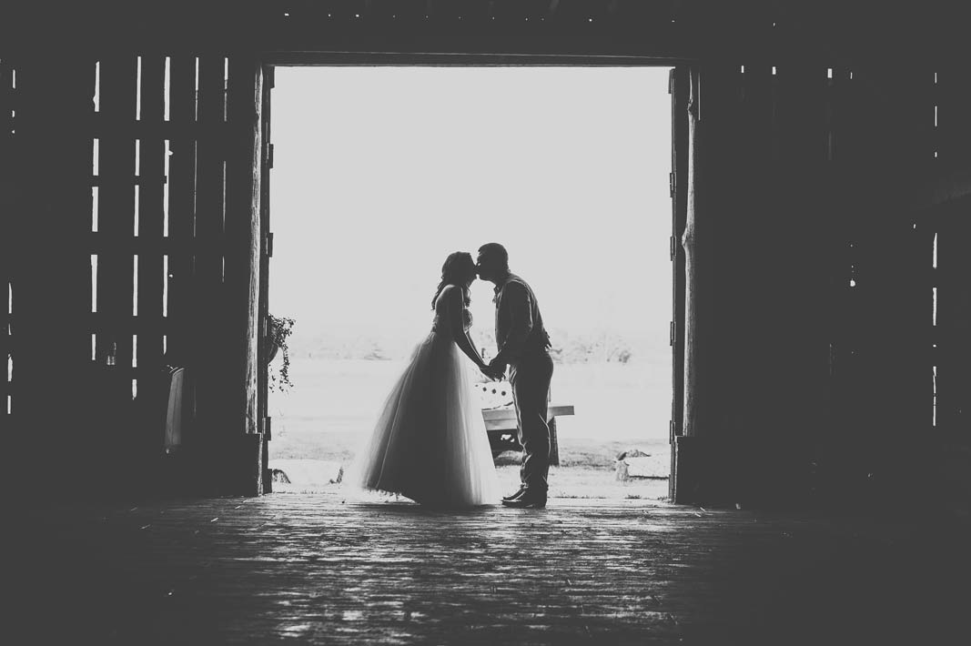 silhouette wedding photo at barn