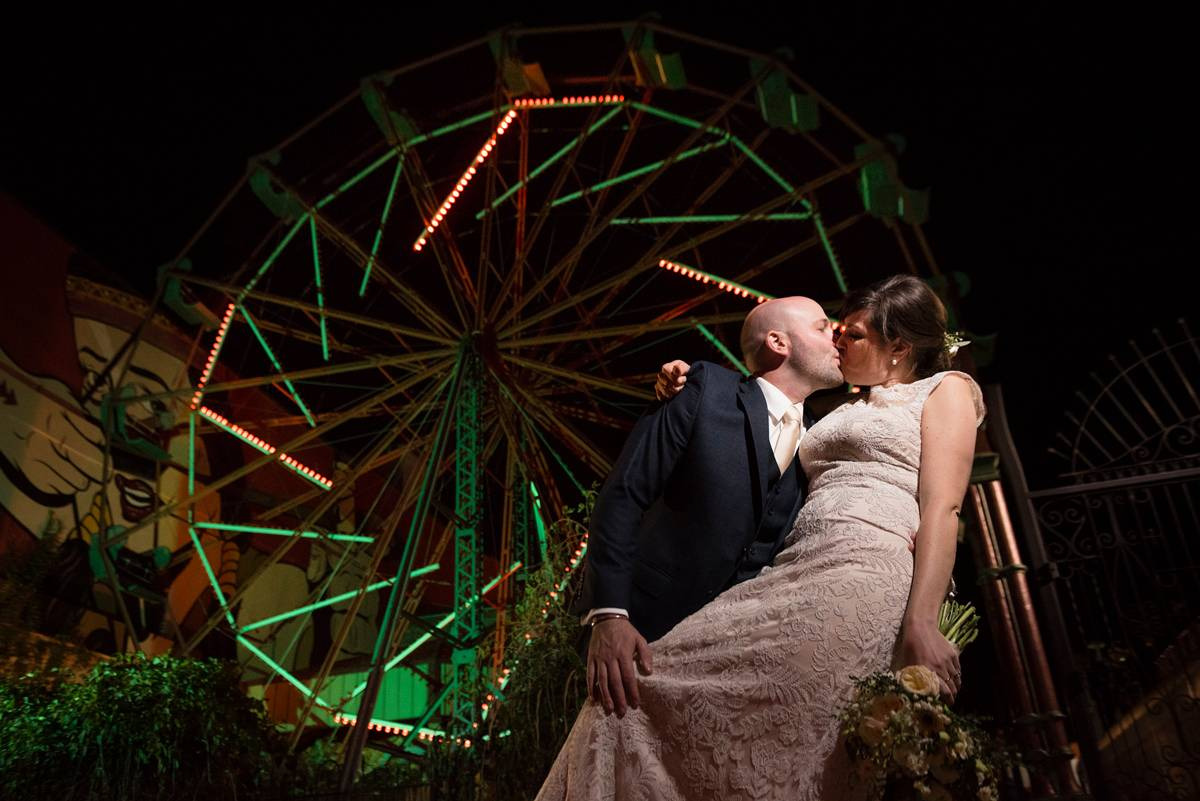wedding photo in front of ferris wheel
