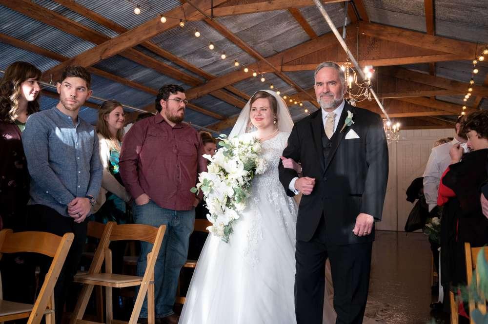 bride walking down aisle at Barn at the Springs