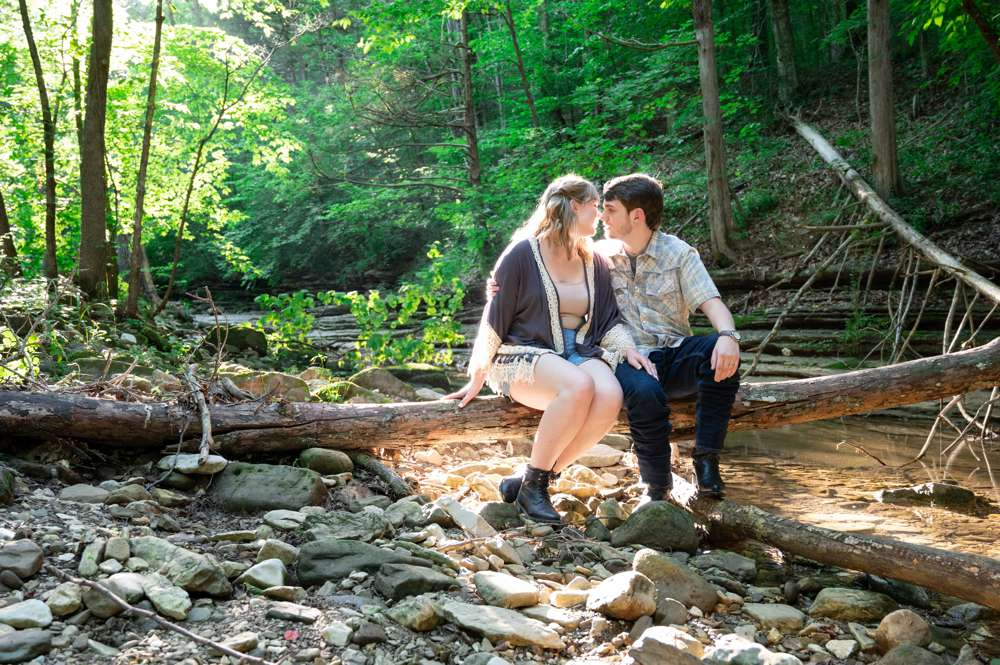 engagement photo on fallen tree