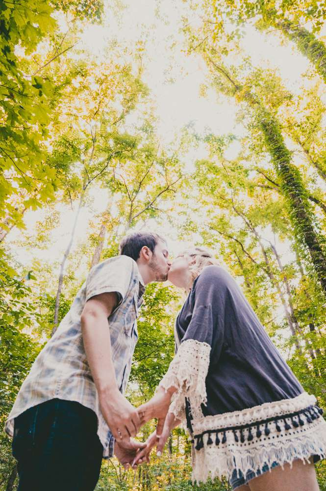 engagement photo with tall trees