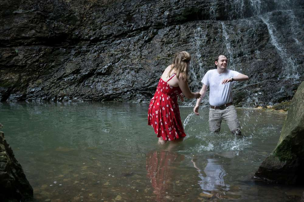 splashing in front of waterfall
