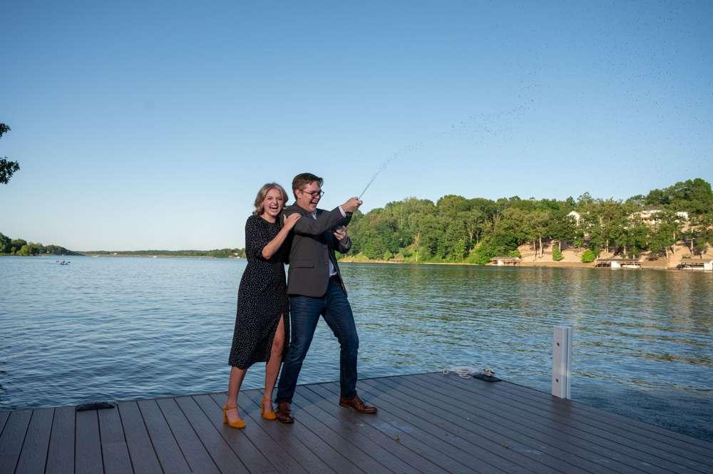 spraying champagne after wedding proposal