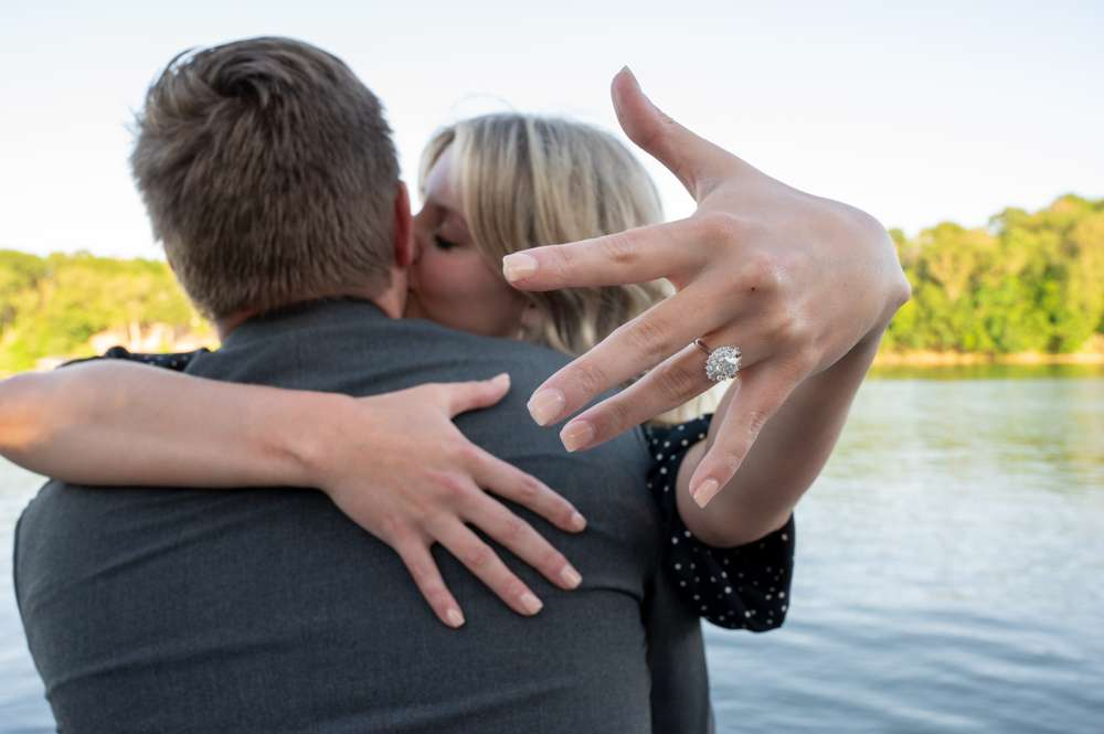 girl showing off engagement ring after proposal