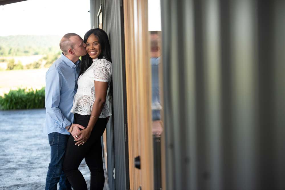 engagement photo against wall