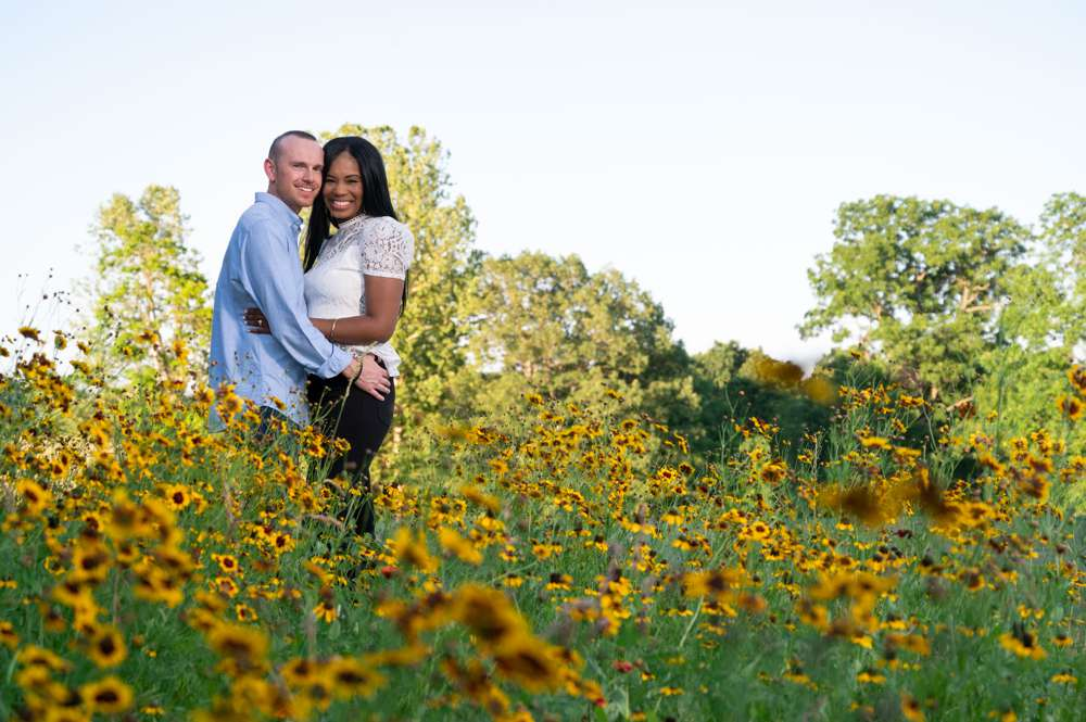 engagement photo in field of flowers