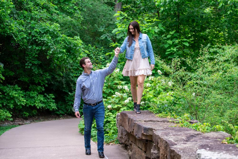 couple walking while guy holds her hand