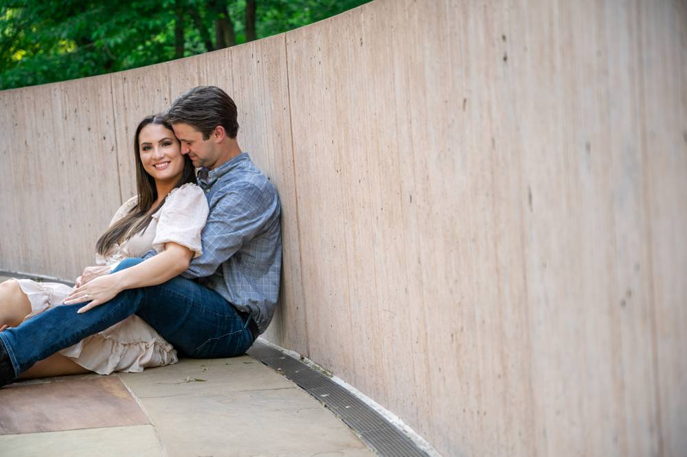 couple leaning against wall at Compton Gardens