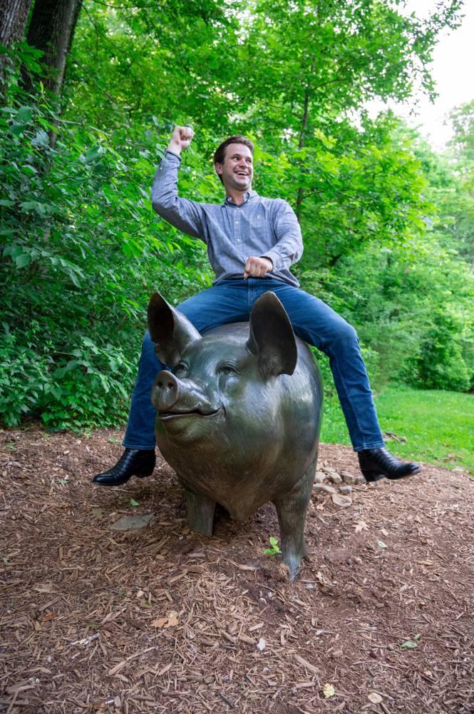guy riding hog statue