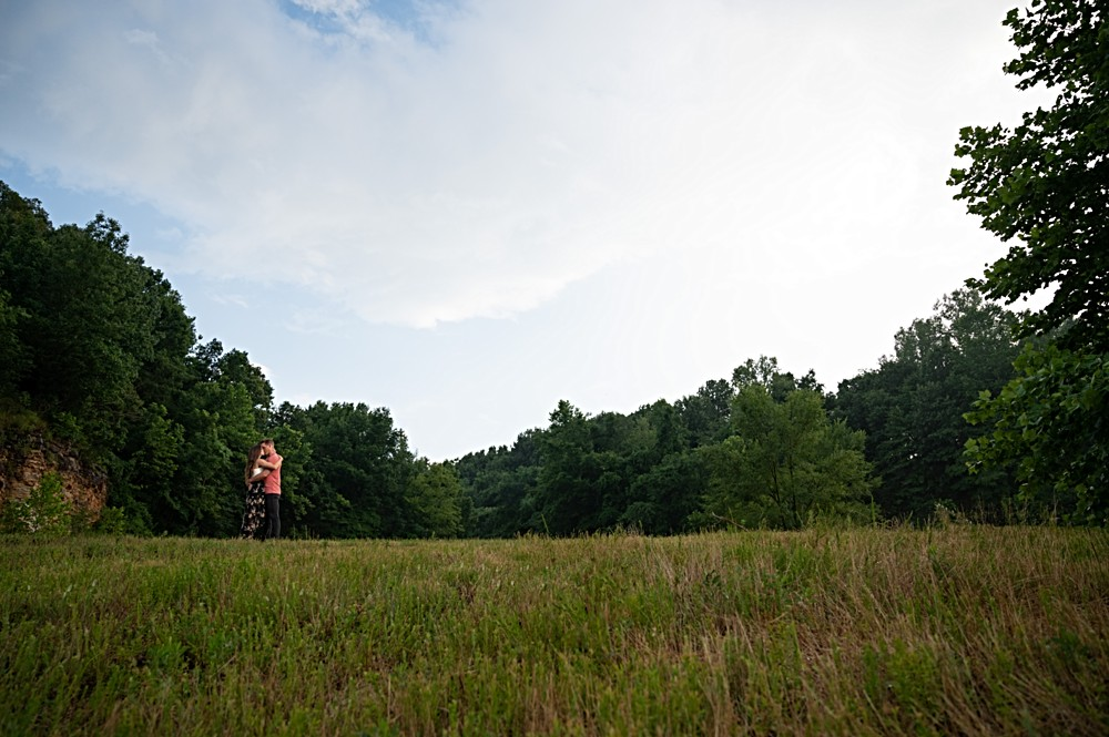 wide shot during engagement session with blue sky