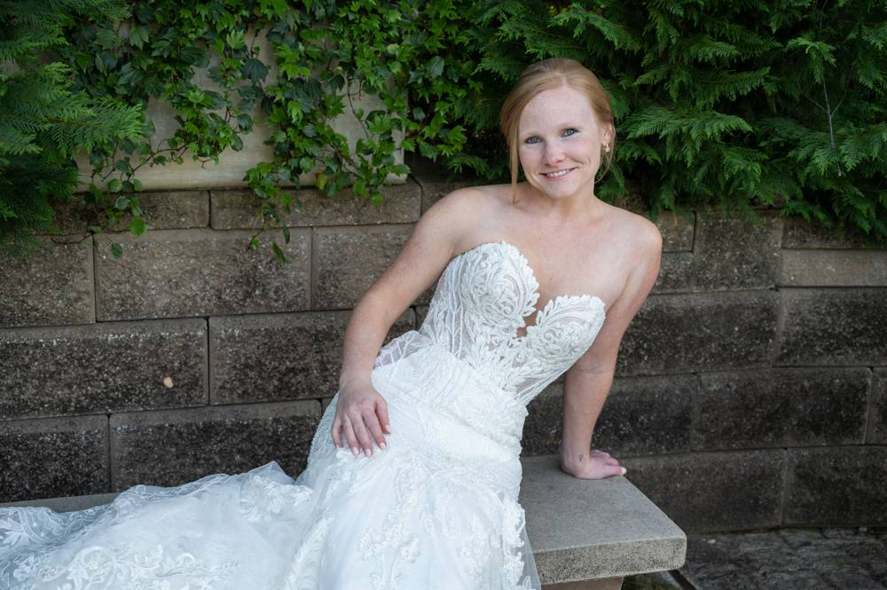 bride on stone bench