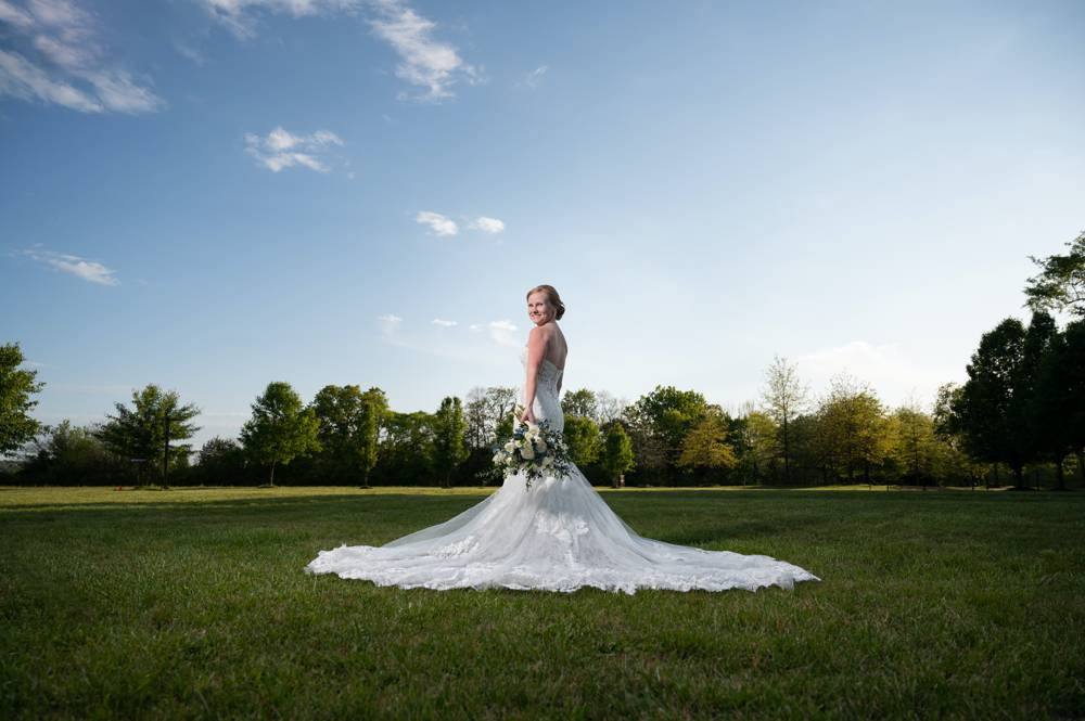 dramatic bridal portrait with blue skies