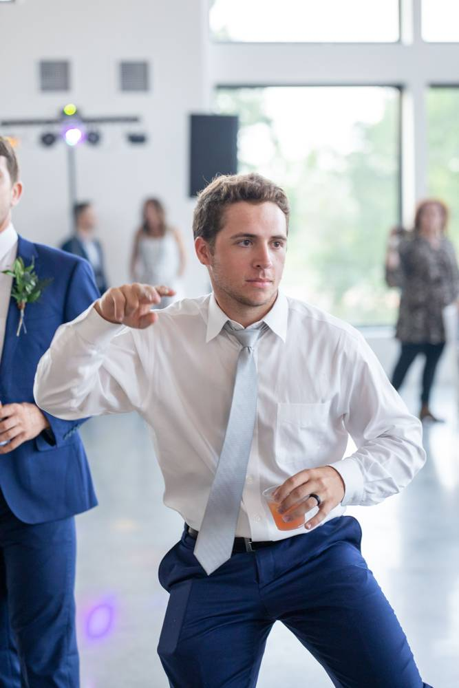 guys dancing at reception at Osage House