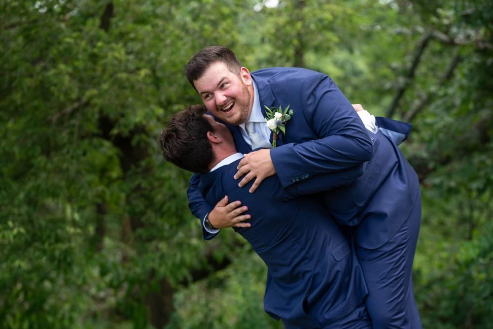 groom behing picked up