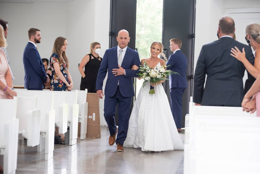 bride coming down the aisle at Osage House