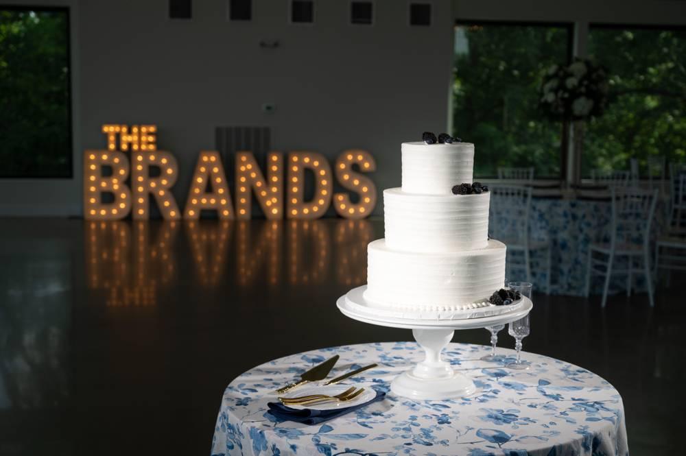 Wedding cake with custom wedding light sign