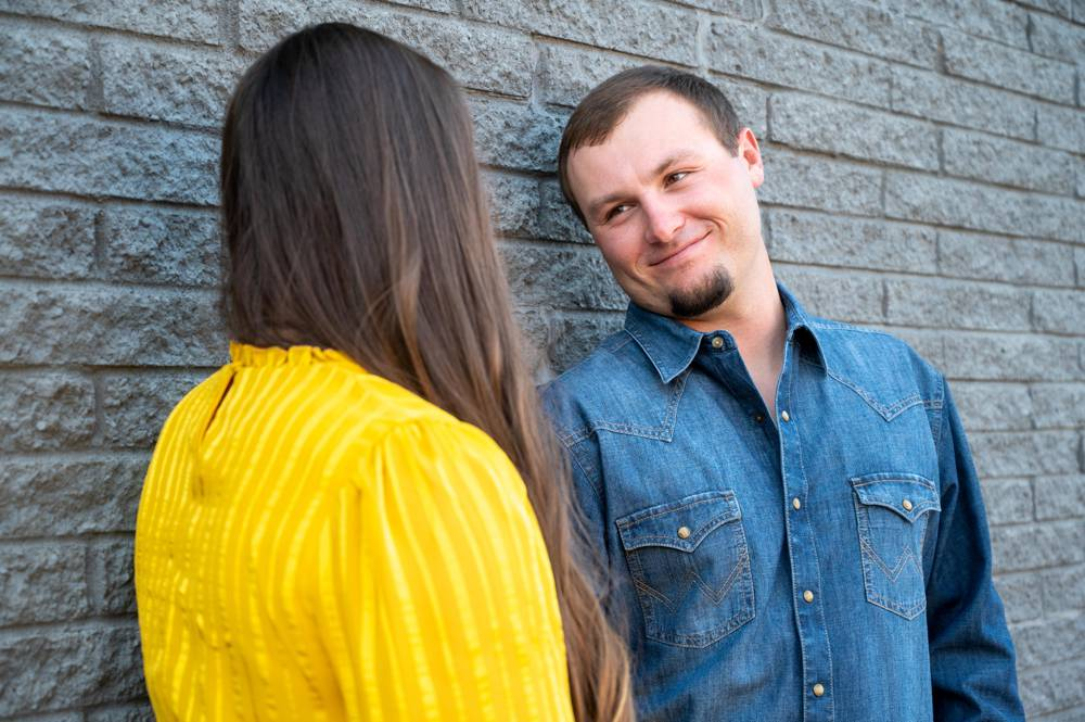guy looking at girl during engagement session