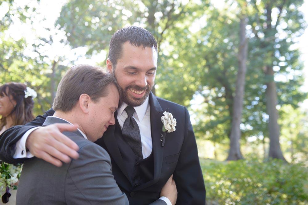 officiant hugging groom