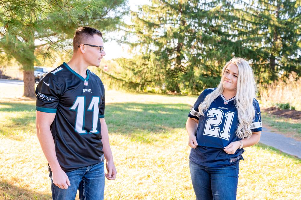 engagement photo with couples wearing NFL Jersey