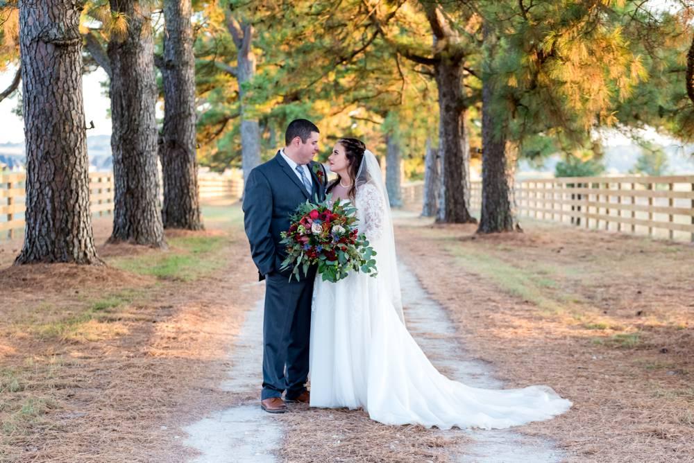 wedding couple in driveway of matt lane farm