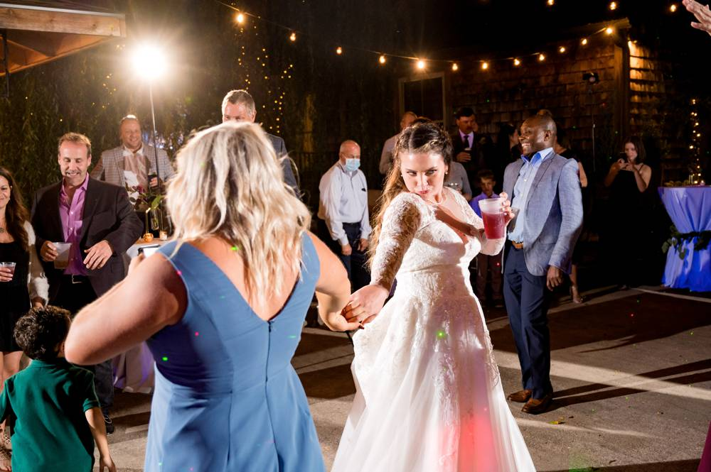 bride dancing with friends at a wedding at the Stone Chapel at Matt Lane Farm