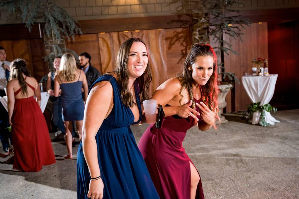 funny bridesmaid dancing at wedding reception