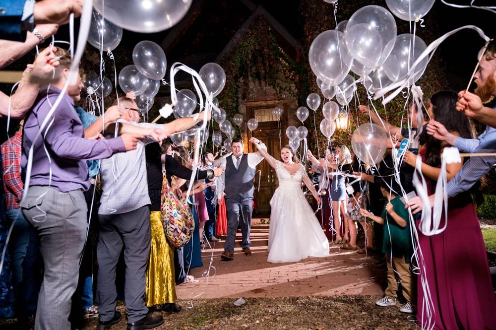 wedding exit at stone chapel at matt lane farm with balloons