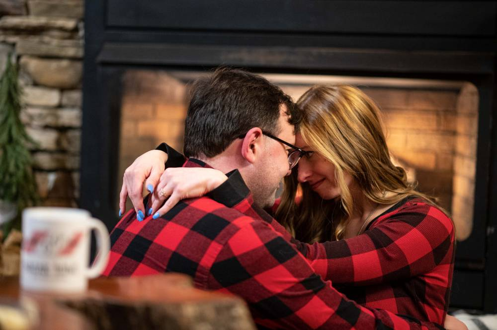 intimate winter themed engagement shoot in cabin in woods