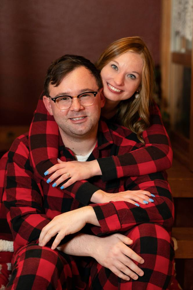 couple in plaid pajamas for engagement shoot