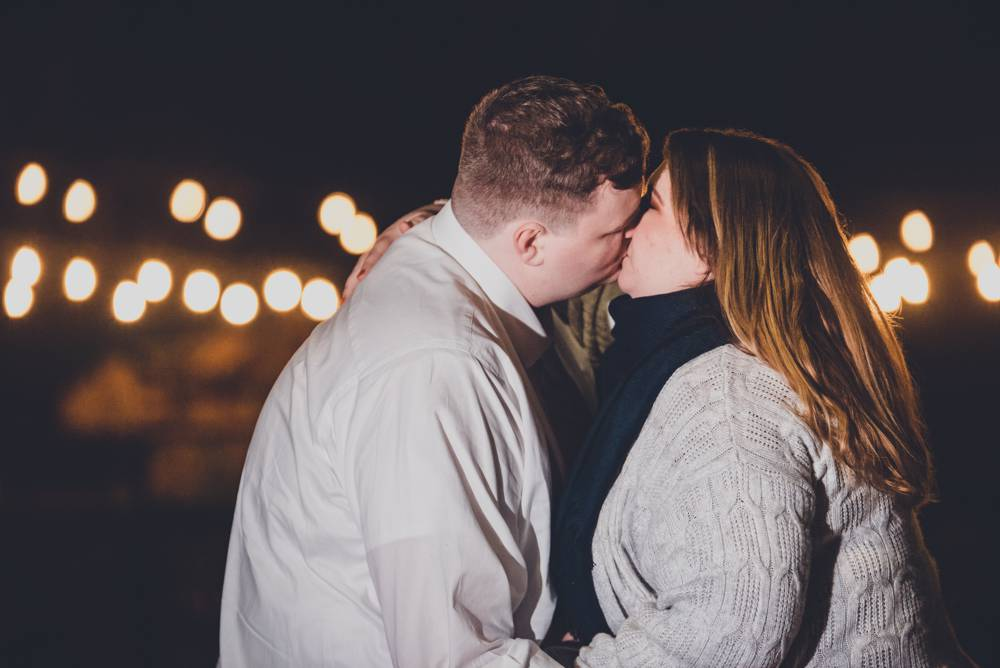 engagement photos with string lights in background
