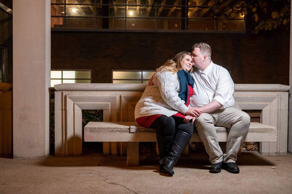 couple sitting on bench at the Muny