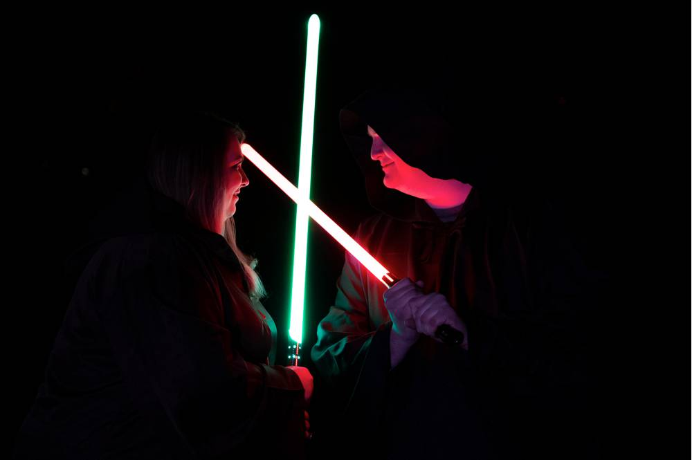 engagement photos with light sabers crossed