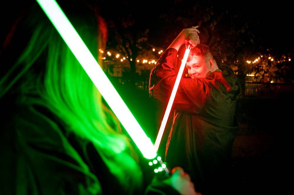 couple with red and green light sabers