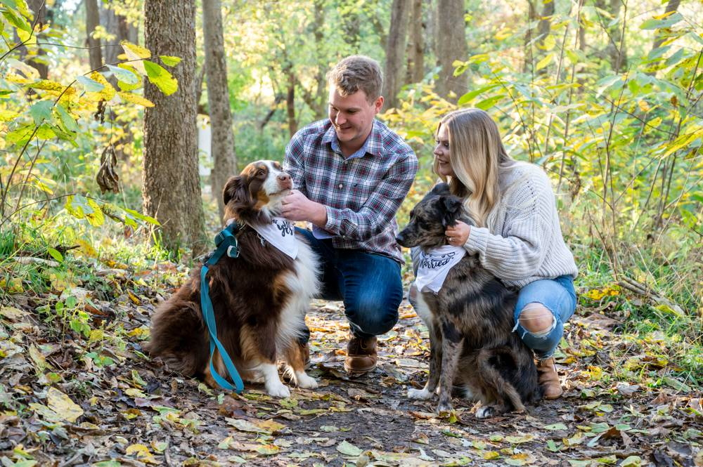 engagement session with couple and dogs in park