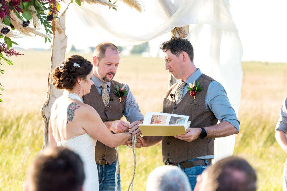 knot tying ceremony at outdoor wedding ceremony