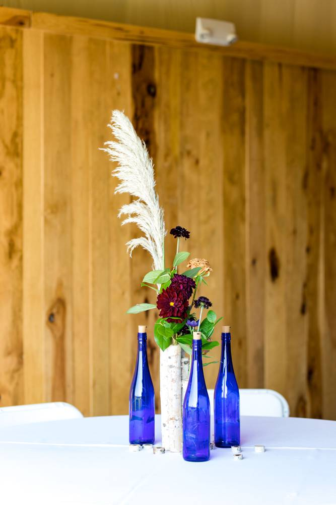 table settings with bottles and flowers